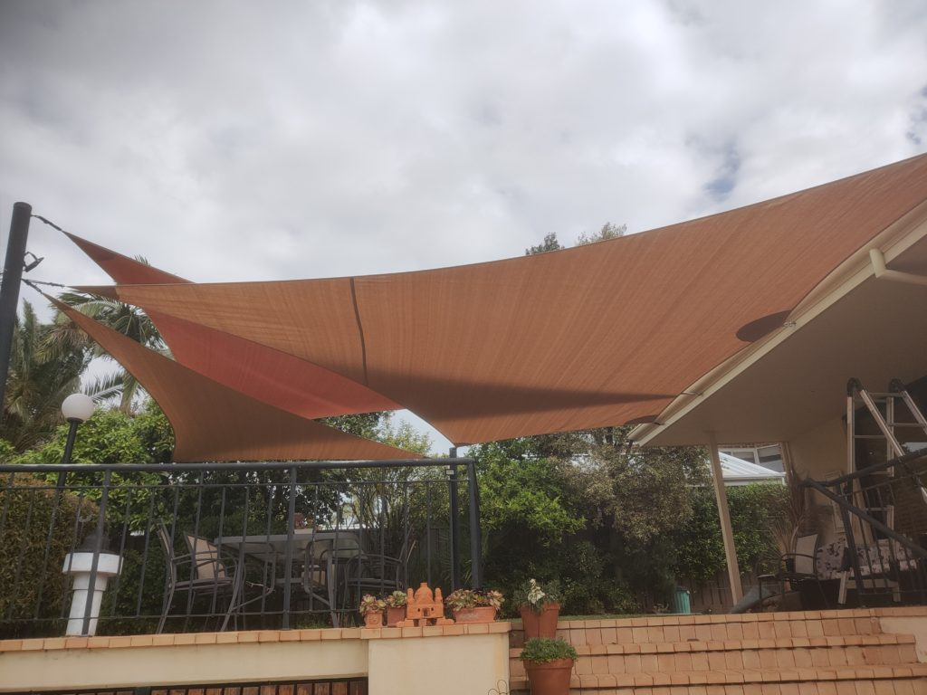 Multiple Shade Sails over a deck