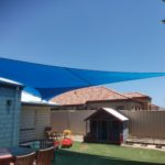 custom made shade sails covering play equipment in a back yard