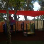 playground custom shade sail in a garden