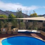 shade sail over deck and pool