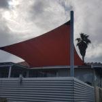square shade sail over a garden