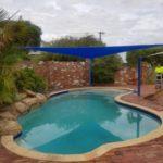 triangle sail shade over a pool